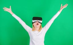 3d technology, virtual reality, entertainment, cyberspace and people concept. Happy woman exploring augmented world. Interacting with digital interface royalty free stock photo