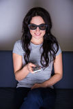 3d television concept - young woman watching movie in 3d glasses Royalty Free Stock Photo