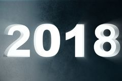 3D Text der Illustration 2018 in der Wand mit hellen Strahlen des Volumens Zahlen 3d Text des guten Rutsch ins Neue Jahr 2018 Stockfotos