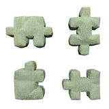 3D textile green puzzles. On isolated background Royalty Free Stock Photos