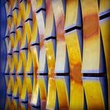 3D texturerad vägg med gula tegelstenar Arkivbilder