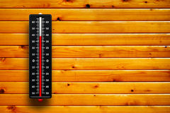 3d Thermometer heat on wood background Stock Photo