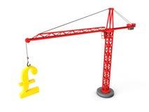 Tower crane lifting golden pound symbol Royalty Free Stock Photo
