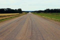 Długa wiejska droga nigdzie Fotografia Stock