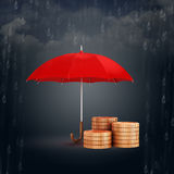 3d umbrella and gold coins, financial savings concept. On dark rainy background Stock Photography