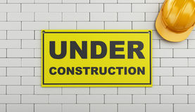 3d Under construction sign on brick wall. Royalty Free Stock Photography
