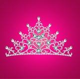 D'une femme avec des joyaux de la couronne de diadème sur le rose Photo libre de droits