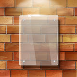3d vector blank glass frame on red brick wall Stock Photos