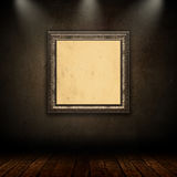 3D vintage picture frame in grunge interior. 3D interior with vintage picture frame on a grunge wall Royalty Free Stock Photos