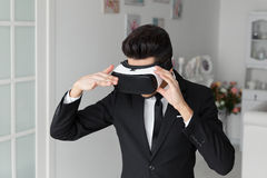 3d vision technology concep, virtual glasses. 3d vision technology concept, video simulation. Young man in suit and virtual glasses. Digital vr device royalty free stock photos