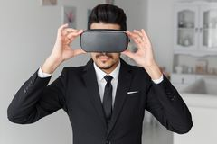 Young businessman in suit and virtual glasses Stock Photography