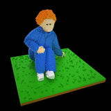 3d voxel sitting boy. 3d image of a redhead boy sitting on grass. Made in retro voxel style,  on black background Royalty Free Stock Photography