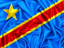 3d waving flag of Democratic Republic of Congo. Silk texture fabric Stock Image
