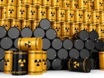 3D, welches die gelben und schwarzen radioaktiven Fässer überträgt Stockbild