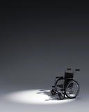 3d Wheelchair in dark background Stock Photography