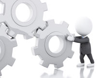 3d White business people pushes a gear. 3d renderer image. White business people pushes a gear. Business concept.  white background Royalty Free Stock Image