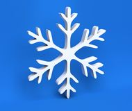 3d white Christmas snowflake isolated on blue background Royalty Free Stock Image