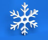 3d white Christmas snowflake isolated on blue background Royalty Free Stock Photos