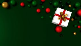 3d white gift box  tied with a red satin ribbon bow. And COLOR balls on green background.for Christmas and HAPPY new year.2018 Royalty Free Stock Photography
