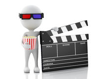 3d white man with clapper board and popcorn. Royalty Free Stock Images