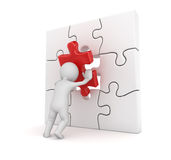 3d white man putting red puzzle piece Royalty Free Stock Image