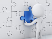 3d white people assemble piece of a puzzle. Royalty Free Stock Photography