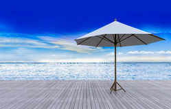 3d white umbrella  on terrace Stock Image