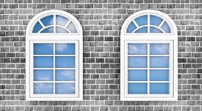 3d windows on the brick wall. With the reflection of the sky in them Royalty Free Stock Photography