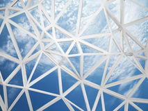 3d wired construction with chaotic triangles shape on blue sky Stock Images