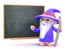 3d Wizard teaching magic at the blackboard. 3d render of a wizard stood in front of a blackboard Royalty Free Stock Image