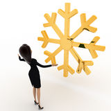 3d woman lookingat golden lucky winter symbol concept Royalty Free Stock Images