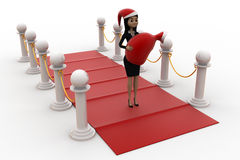 3d woman on red carpet with santa hat and gift bag concept Royalty Free Stock Photos