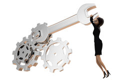3d woman tightening nut and gears using mechanical wrench concept Royalty Free Stock Image