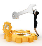 3d woman tightening nut using wrench and service gears with it concept Stock Photography