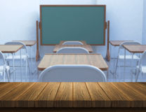 3D wood table with defocussed classroom Royalty Free Stock Images