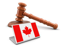 3d wooden mallet and Canada flag Stock Photography