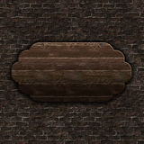 3D wooden sign on brick wall. 3D render of old wooden sign on brick wall Royalty Free Stock Images