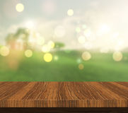 3D wooden table looking out to a countryside view Stock Image