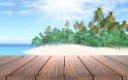 3D wooden table looking out to a tropical island in sea Royalty Free Stock Image