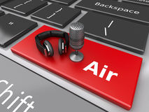 3d Word air with a mic and headphones on computer keyboard. 3d renderer image. Word air with a mic and headphones on computer keyboard Royalty Free Stock Images