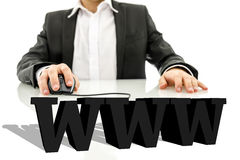 3d www. Businessman sitting at his desk surfing the net. Virtual 3d www sign on his desk. Internet concept Royalty Free Stock Photos