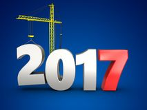 3d 2017 year with crane. 3d illustration of 2017 year with crane over blue background Royalty Free Stock Photo