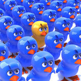 3d Yellow chick stands out from crowd of blue chicks Royalty Free Stock Photo