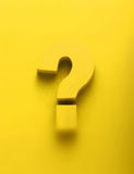 3d yellow question mark on a yellow background Royalty Free Stock Photos
