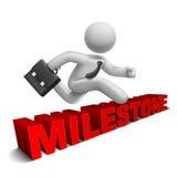 3d zakenman die over 'mijlpaal' woord springen Stock Foto