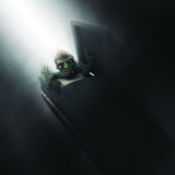 3D zombie emerging out of a coffin Royalty Free Stock Photo