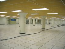 D7556 Data Center. Largely empty datacenter with air conditioning units and cabling stock photos