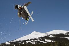 D78 Superpipe skier. Skier takes air in superpipe competition Royalty Free Stock Images