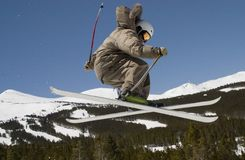 D79 Superpipe skier. Skier launches at superpipe competition Royalty Free Stock Photos