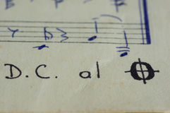 Da Capo al Fine in a music book. With hand-written notes close up Royalty Free Stock Photography